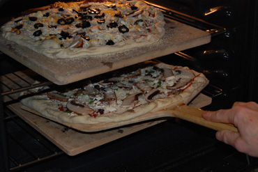 sliding pizza onto stone
