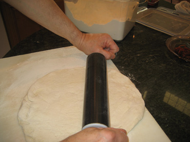 rolling pizza dough rolling pin