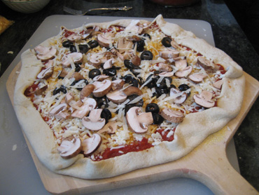 homemade pizza ready to bake