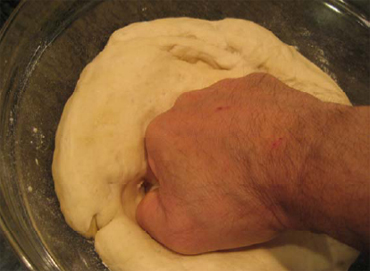 punch down the pizza dough